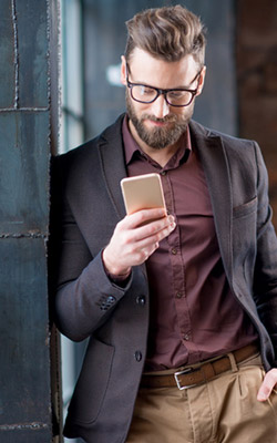 Man wearing glasses using his smartphone